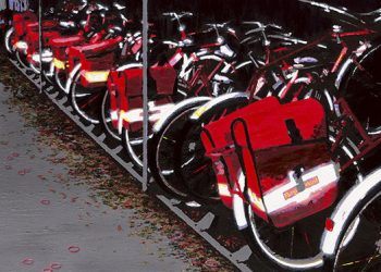 Royal Mail bikes snuggle up for the night in Weybridge, Surrey.